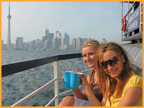 two-young-ladies-enjoying-a-drink-on-the-side-deck
